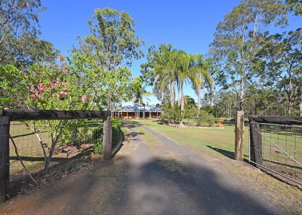 BEAUTIFULLY RENOVATED HOME ON APPROX 10 ACRES